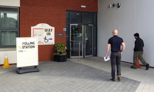 Voters enter at a polling station in Sydenham, east Belfast, earlier today.
