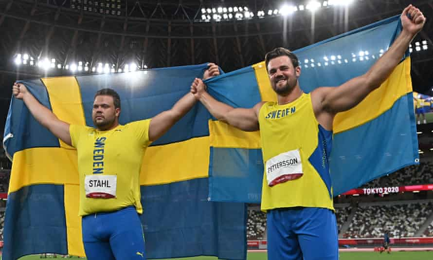 Daniel Stahl (L) and silver medallist Sweden's Simon Pettersson celebrate.
