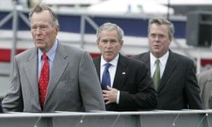 George HW Bush walks with his sons George W Bush and Jeb Bush.