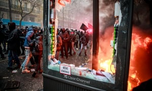 Protesters clash with French riot police during the demonstration against pension reforms in Paris.