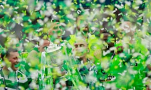 Celtic's Scott Brown lifts the trophy as he celebrates winning the Scottish Cup final.