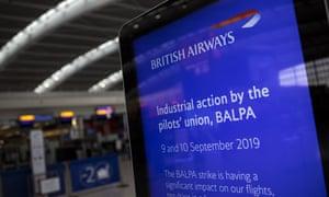 Empty British Airways check-in with strike information displayed