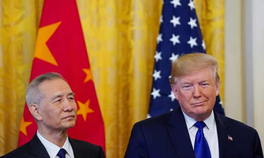 Trump with Liu He, China's top trade negotiator. He said: 'At long last Americans have a government that puts them first at the negotiating table.'