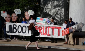 People protest before the EPA administrator, Scott Pruitt, testifies before a House energy and commerce subcommittee in Washington last month.