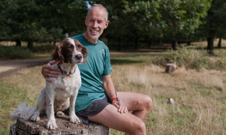 Parkrun founder Paul Sinton-Hewitt with his dog, Dorothea.