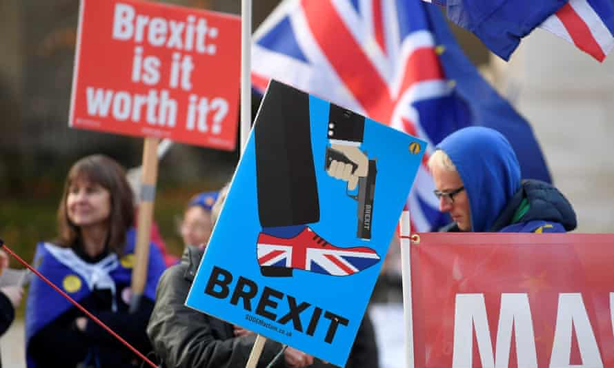 Anti-Brexit protesters bearing placards in Whitehall on Sunday.