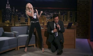 Killing them softly: Miley Cyrus and Jimmy Fallon take part in one of the host's trademark song and dance routines