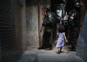 Rio de Janeiro, Brazil: Brazilian soldiers on patrol in the Rocinha favela. The army entered the favela last week in a continuing operation after violence involving drug gangs
