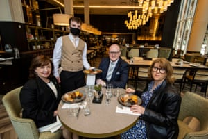 Diane Dodds, Northrern Ireland's economy minister (left) marking the reopening of indoor hospitality in the region today at the Grand Central Hotel in Belfast with Janice Gault (right) of the Northern Ireland Hotels Federation (NIHF) and general manager Stephen Meldrum (second from right) over breakfast.
