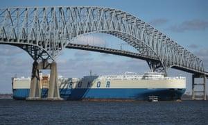 a freighter ship passes baltimore bridge