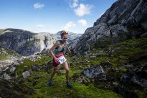Female winner Ane Guro Moen at Hardangervidda marathon goes through parts of the National Park passing through glaciers and waterfalls, Eidfjord, Norway