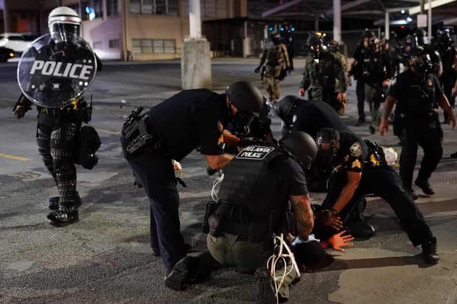 Police detain a protester on 30 May in Atlanta, Georgia.