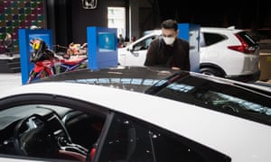 A man on the site of the Geneva Motor Show, which has now been cancelled due to fears about the coronavirus.