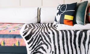 A faux-fur zebra throw and cushions