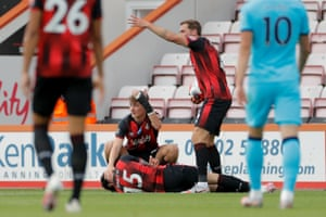 Adam Smith's Bournemouth's teammates call for the medical staff as Smith suffered a head injury.