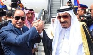 President Abdel Fatah al-Sisi, left, shakes hands with King Salman