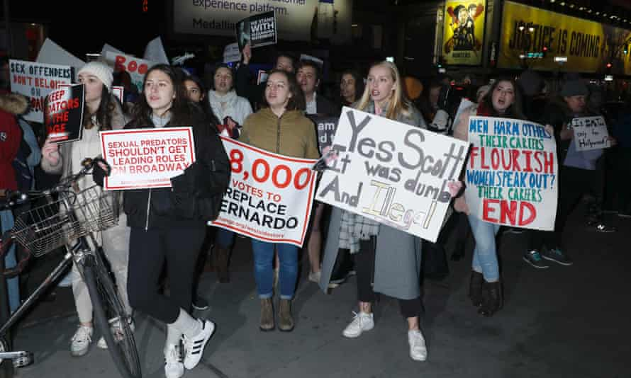 Protesters oppose the casting of Amar Ramasar as Bernardo outside the premiere of West Side Story at the Broadway Theatre.