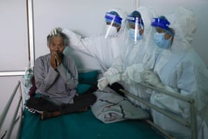 Frontline health workers bid farewell to Kaile Tamang, 74, after recovering from Covid-19 in Kathmandu, Nepal