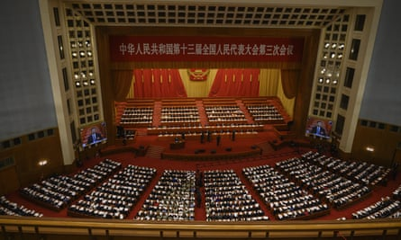 China's Communist Party leaders and delegates, including president Xi Jinping, sit at the opening of the National People's Congress on May 22, 2020 in Beijing, China