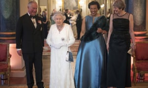The Queen is joined by Prince Charles, Lady Scotland and Theresa May in Buckingham Palace.