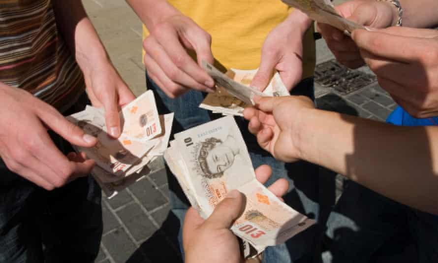Teenagers with bank notes