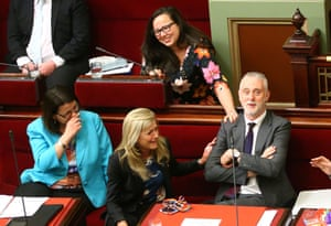 Gavin Jennings MP is congratulated as the voluntary assisted dying bill passes the upper house of Victoria's parliament.