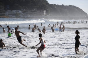 Tokyo, Japan: People enjoy the beach near Enoshima island on the coast of Kanagawa prefecture