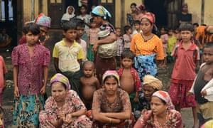 Muslim Rohingyas in the courtyard of a school sheltering displaced people in the village of Theik Kayk Pyim, on the outskirts of Sittwe, capital of Myanmar's western Rakhine state.