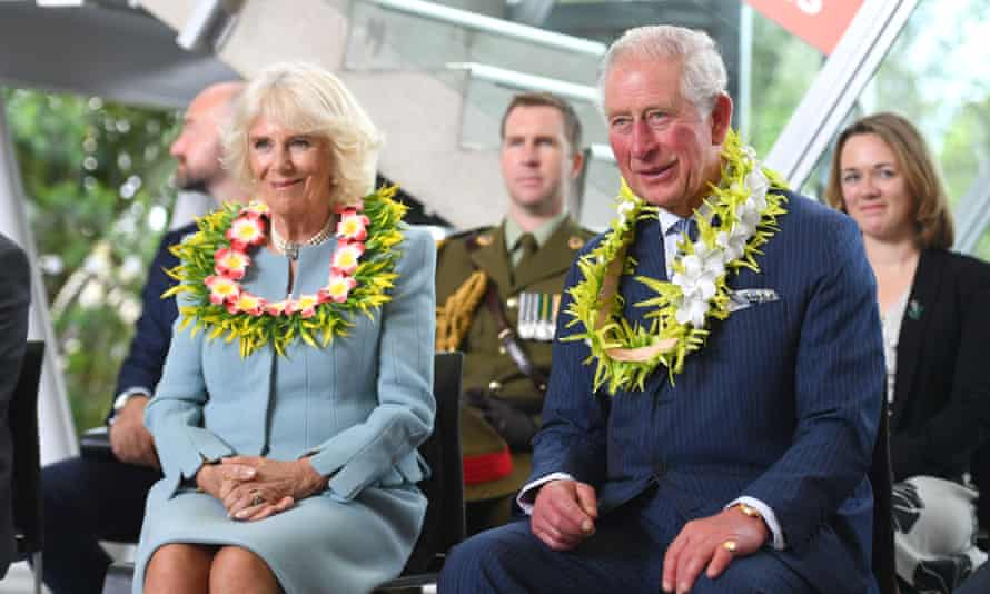 Camilla and Charles with wreaths around their necks