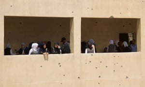 Pupils at a bullet-riddled school in West Mosul, Iraq