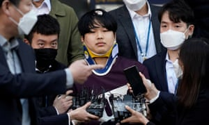 Cho Ju-bin, alleged leader of South Korea's online sexual blackmail ring, walks out of a police station as he is transferred to a prosecutor's office in Seoul