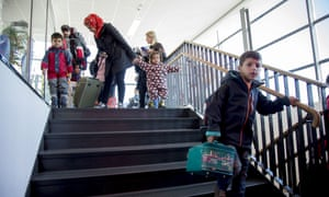 Passengers, among them migrants and refugees, exit the ferry terminal in Goteborg, Sweden.