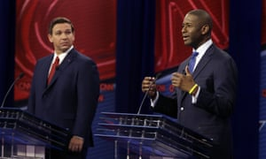 The Florida Democratic gubernatorial candidate Andrew Gillum, right, speaks as his Republican opponent Ron DeSantis looks on during a CNN debate on Sunday in Tampa.