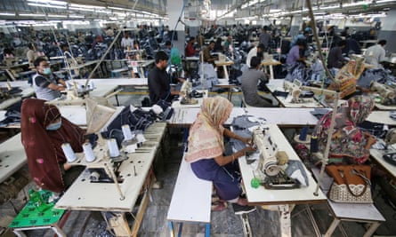 Workers at a garments factory in Karachi. The textile industry is the largest manufacturing industry in Pakistan.
