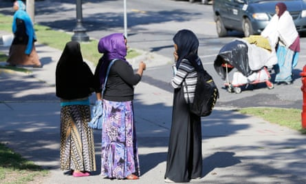 Members of the Somali community visit near a park in Minneapolis