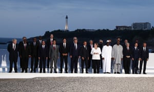 Angela Merkel amidst a throng of male world leaders at the G7 summit in Biarritz.