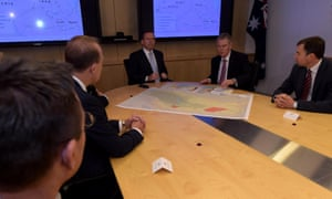 Tony Abbott and director general of security Duncan Lewis speak at the start of a classified briefing at Asio headquarters in Canberra.