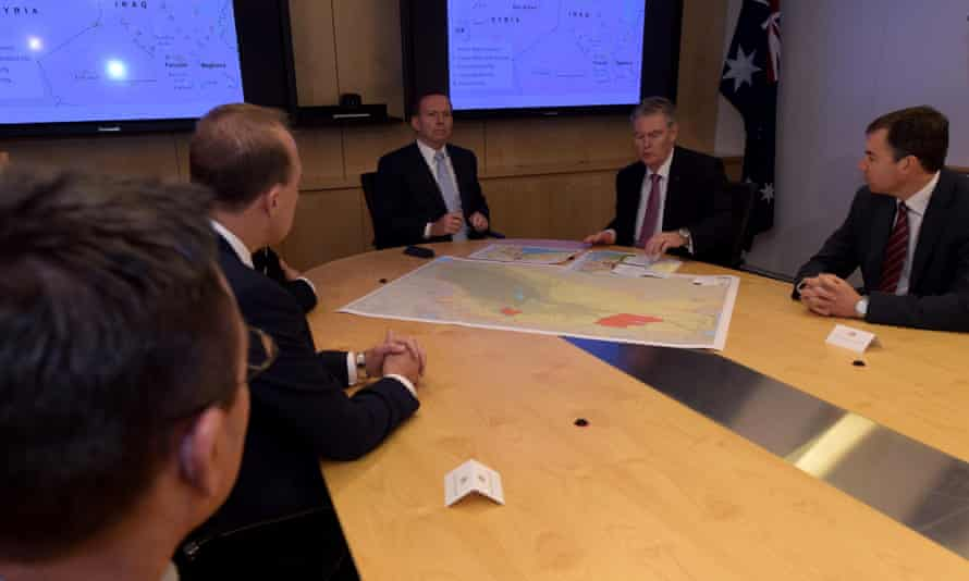 Tony Abbott and the director general of security and intelligence, Duncan Lewis, (right) speak at the start of a classified briefing at Asio's headquarters in Canberra.