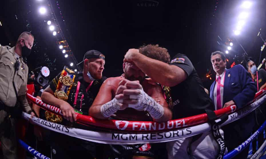 Tyson Fury says a tearful prayer at ringside with his brother, Shane, in the immediate aftermath of his victory over Deontay Wilder.