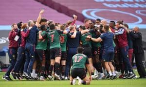 Aston Villa players and staff celebrate their Premier League survival.