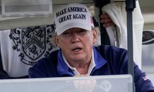 Donald Trump drives a golf cart in Sterling, Virginia, on Sunday. Photograph: Joshua Roberts/Reuters