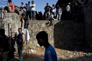 Lesbos, Greece Migrants wait to be registered by the police after arriving at the port.