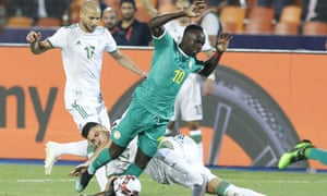 Algeria's Amir Bensebaini tackles Senegal's Sadio Mané in a disappointing Africa Cup of Nations final in Cairo.