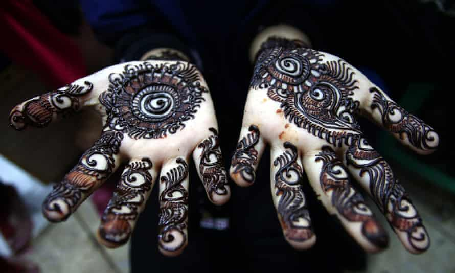 Close up of henna tattoo drying on a girl's hands.
