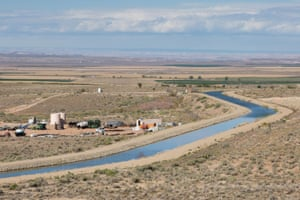 Irrigated fields at Ute Mountain Farm and Ranch bring some green to the otherwise arid plains of southwestern Colorado