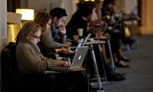People work on laptops at the British Library in London