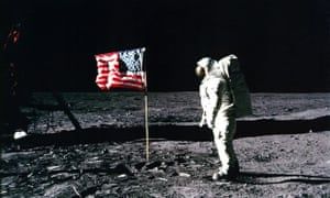 """Apollo 11 astronaut Edwin """"Buzz"""" Aldrin standing by the US flag planted on the surface of the moon on 20 July 1969."""