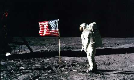 "Apollo 11 astronaut Edwin ""Buzz"" Aldrin standing by the US flag planted on the surface of the moon on 20 July 1969."