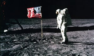 Apollo 11 astronaut Edwin 'Buzz' Aldrin standing by the US flag planted on the surface of the moon on 20 July 1969