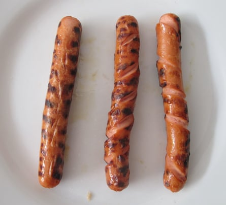 Skinless sausages cooked whole, slashed and spiral cut.
